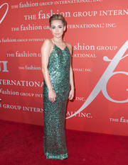 Miley Cyrus looked tame (and elegant) for a change in a sequined blue Marc Jacobs halter gown during the Annual Night of Stars.