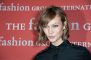 Karlie Kloss stuck to her usual short wavy cut with bangs when she attended the Annual Night of Stars.