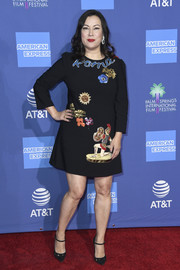 Jennifer Tilly paired her dress with embellished black Mary Jane pumps.