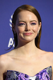 Emma Stone went for a colorful beauty look with a swipe of pink and purple eyeshadow.