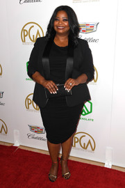 Octavia Spencer styled her look with a pair of gold sandals.