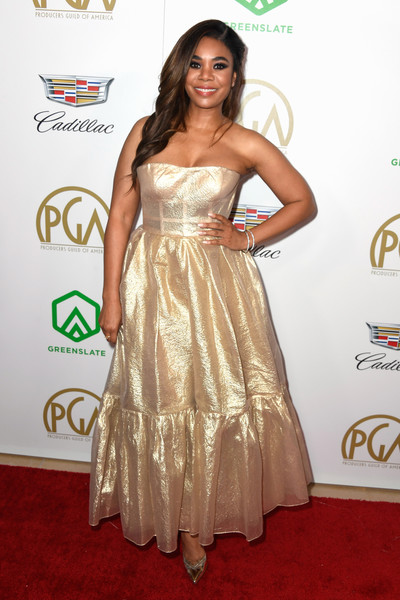 Regina Hall was all aglow in a strapless gold gown by Reem Acra at the 2019 Producers Guild Awards.