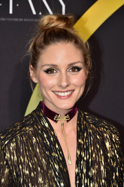 Olivia Palermo styled her hair into a cute top knot for the FN Achievement Awards.