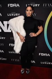 Dascha Polanco opted for a black ruffle-sleeve jumpsuit by Kenya Mills for her FN Achievement Awards red carpet look.