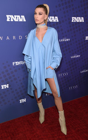 Hailey Baldwin was ultra modern in an asymmetrical sky-blue tunic dress by Fendi at the 2017 FN Achievement Awards.