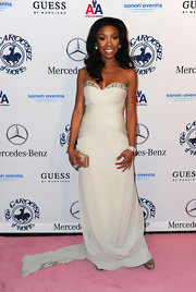 Brandy looked elegant at the Carousel of Hope gala in a white gown with a sweetheart neckline and draped bodice.