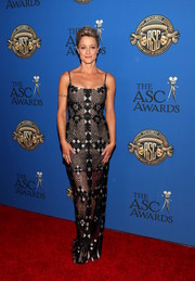 Teri Polo flaunted her figure in a form-fitting mesh gown at the American Society of Cinematographers Awards.