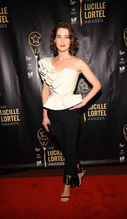 Cobie Smulders got dolled up in a white one-shoulder top with ruffle and peplum detailing for the Lucille Lortel Awards.