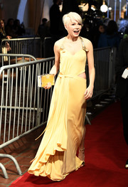 Michelle Williams arrived for the Santa Barbara International Film Festival carrying a modern yellow box clutch by Louis Vuitton.