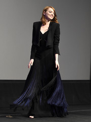 Emma Stone stepped onstage at the Santa Barbara International Film Fest wearing a black cropped jacket over a fringed gown.