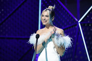 Dua Lipa paired pink nail polish with a feathered off-the-shoulder dress for her sweet look at the 2019 ARIA Awards.