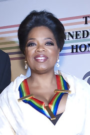 Oprah Winfrey swept her hair up in a loose bun for an elegant finish at the Kennedy Center Honors.
