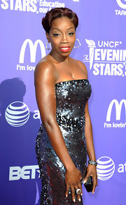 Estelle accented her glam sequined gown at the UNCF Evening of Stars with a glittery black crystal Kiosque clutch.