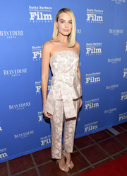 Margot Robbie styled her outfit with silver slim-strap heels by Jimmy Choo.