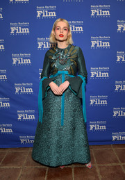 Lucy Boynton gave us medieval vibes in this beaded teal gown by Gucci at the 2019 Santa Barbara International Film Festival.