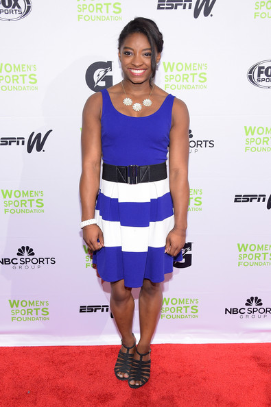 Simone Biles attended the Salute to Women in Sports event wearing a boldly striped dress.