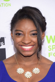 Simone Biles completed her accessories with a pair of diamond studs.