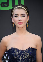 Jacqueline MacInnes Wood accessorized with a pair of dangling gemstone earrings during the Daytime Emmys.