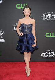 Jacqueline MacInnes Wood looked ultra girly at the Daytime Emmys in her navy strapless dress featuring a corset bodice and a tiered skirt.
