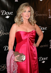 Morgan Fairchild paired a metallic gold clutch with her alluring dress for a totally glam finish.