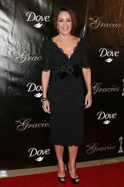 Patricia Heaton kept her ladylike evening dress classic with black platform stilettos.