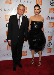 Catherine looked glamorous in a Fall 2009 tulle overlaid cocktail dress with black floral embellishments.