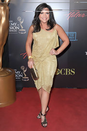 Rachel Roy glowed in a golden cocktail dress.