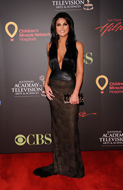 Nadia looked sultry at the Daytime Emmys in a low cut black evening gown.