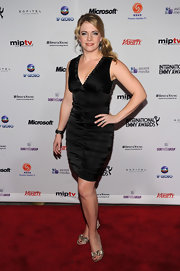 Melissa Joan Hart added a glam touch to her black ruched cocktail dress with gold bow-adorned peep toes.