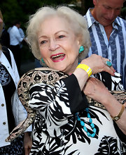 Betty White jazzed up her look with a turqouise gemstone ring.