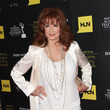 Suzanne Rogers in white and cream tone-on-tone