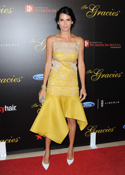 Angie Harmon chose a floral-embroidered yellow and nude cocktail dress with an asymmetrical hem for the Gracie Awards.
