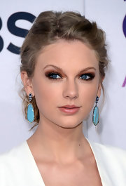 What?! No red lip? Taylor's pucker was refreshingly bare at the 2013 People's Choice Awards.