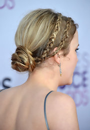 These messy braided headbands put a stylish twist on Taylor's low ballet bun.