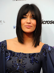 Jessica Szohr wore her hair in straight, choppy layers with sexy lash-grazing bangs at the 39th International Emmy Awards.