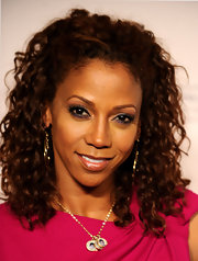 Actress Holly Robinson Peete showed off her curly mane while attending an event in Beverly Hills.