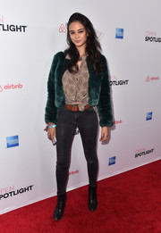 Courtney Eaton elevated her casual look with an emerald-green fur jacket.