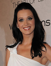 Katy Perry and soon to be Mrs. Russel Brand was all smiles as she showed off her half-up half-down hair-style. Her jet black hair gives her white dress great contrast.