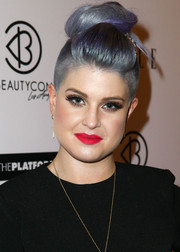 Kelly Osbourne attended the BeautyCon Summit wearing a flamboyant top knot/pompadour/undercut 'do.
