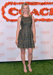 Amy Smart showed off her fit figure with this multi-colored tweed A-line.