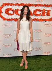 Abigail Spencer wore a fitted white leather dress with a cinched waist to the Coach CDF benefit.