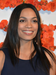 Rosario Dawson opted for a straight 'do with a sleek center part for her look at the Coach Benefit for the Children's Defense Fund.