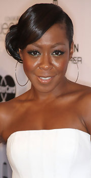 Tichina Arnold styled her hair in an elegant side bun for the Essence Black Women in Hollywood Luncheon.