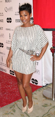 Nia long looked sensational in a draped sequin dress, which she paired with a sparkling belt and ankle boots.