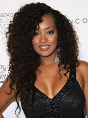 Jennia Fredrique attended the 3rd Annual 'Essence' Black Women in Music event wearing her long tresses in big bouncy curls with a sexy side part.