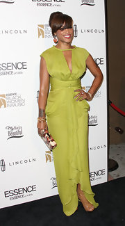 Eve wore a chartreuse silk gown to the 'Black Women in Music' event.