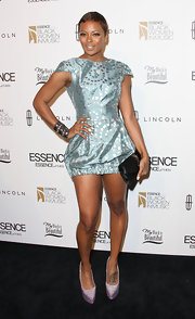 Eva Pigford strutted down the red carpet of the Black Women in Music event in a metallic print mini dress.