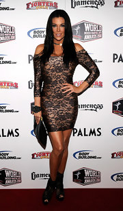 Angelica Bridges matched an uber fitted lace dress to her cutout lace ankle boots for a not so subtle red carpet look.