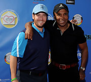Sugar Ray Leonard attended the celebrity golf tournament showing off his sporty side in a logo baseball cap.