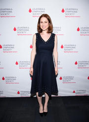 Ellie Kemper wore a navy midi dress with a studded neckline and hem to the LOL with LLS event.